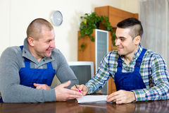 Two workers study documents Stock Photography