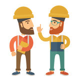 Two workers talking. Royalty Free Stock Photography