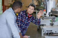 Two workers workers in warehouse. Men royalty free stock photo