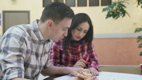 Two workers woman man discussing business project in office. stock footage