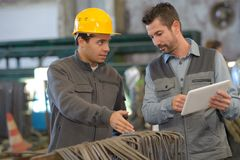 Two workers working in factory. Two workers working in a factory Stock Images
