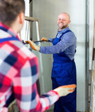 Two workers working with glass Royalty Free Stock Image