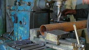 Two Workers Working With Pipe And Drill stock video footage