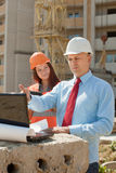 Two workers works on the building site Stock Photography