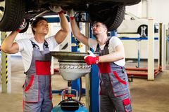 Two workers in a workshop Royalty Free Stock Image