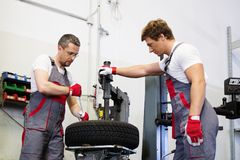 Two workers in a workshop royalty free stock photo