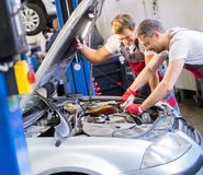 Two workers in a workshop Royalty Free Stock Photography
