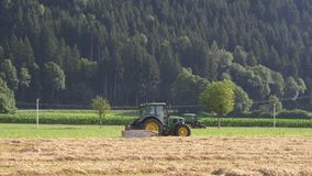 Two working on the field farm tractors stock footage