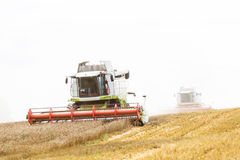 Two Working Harvesting Combine in the Field of Wheat. Working Harvesting Combine in the Field of Wheat stock photos