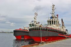 Two working ships in the Vagen harbor in Stavanger, Norway. Stock Photography