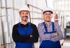 Two workmen in helmets at workshop Royalty Free Stock Photo
