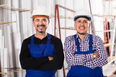 Two workmen in helmets at workshop Royalty Free Stock Photography