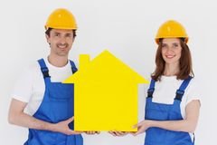 Two workmen holding house symbol Royalty Free Stock Images