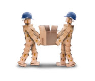 Two workmen lifting a box Stock Photo