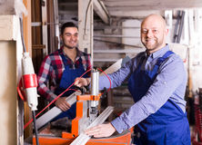 Two workmen in PVC shop Stock Images