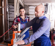 Two workmen in PVC shop Royalty Free Stock Photography