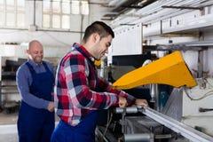 Two workmen in PVC shop Royalty Free Stock Photos