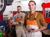 Two workmen toiling in workshop Stock Images