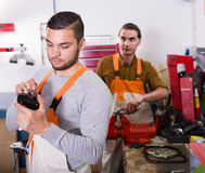 Two workmen toiling in workshop Royalty Free Stock Photography