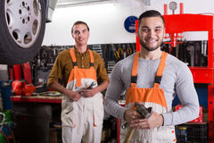Two workmen toiling in workshop Royalty Free Stock Photo