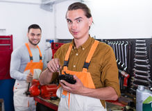 Two workmen toiling in workshop Stock Photo