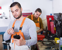 Two workmen toiling in workshop Stock Photos