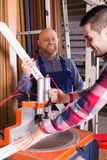 Two workmen working on machine Royalty Free Stock Photography