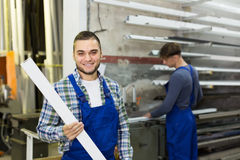 Two workmen working with PVC  profiles Stock Photo