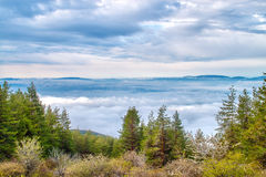 Between two worlds. Between two layers of clouds royalty free stock images