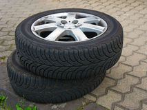 Two worn old tires with discs. Lying on the road Stock Photography