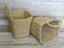 Two woven baskets made of straw, rattan, cane. Beautiful Handmade Woven Bamboo / Cane Basket. stock image