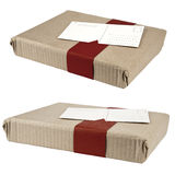 Two wrapped boxes and attached postcard Stock Photography