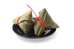Two wrapped Chinese rice dumplings Royalty Free Stock Photo
