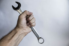 Two wrenches in hand. On white background Stock Images