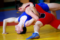 Two wrestlers Greco-Roman wrestling competitions. Chelyabinsk, Russia, on January 17, 2015: Two wrestlers Greco-Roman wrestling during Championship of Royalty Free Stock Photos