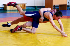 Two wrestlers Greco-Roman wrestling competitions. Chelyabinsk, Russia, on January 17, 2015: Two wrestlers Greco-Roman wrestling during Championship of Stock Images