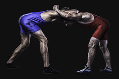 Two wrestlers holding each other in stand  Stock Photos