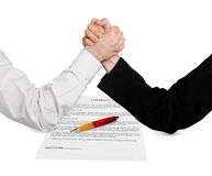 Two wrestling hands and contract Stock Photos