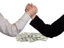 Two wrestling hands and money Stock Image