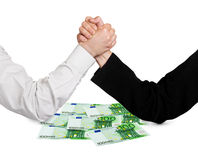 Two wrestling hands and money Stock Images