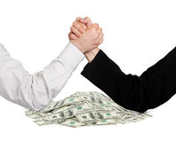 Two wrestling hands and money Stock Photography