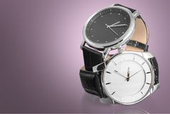 Two wrist watches, close-up view. Wrist two watches black dial group white objects Royalty Free Stock Image