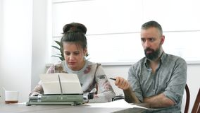 Two writers man and woman at work. Having strong emotions about text stock video