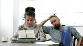 Two writers man and woman at work. Having strong emotions about text stock video footage