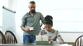 Two writers man and woman at work. Having strong emotions about text stock footage