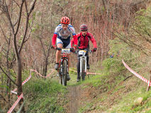 Two xc riders in narrow. Two xc riders passing a narrow part of trail. Cross-country cycling trail in Odessa, Ukraine Stock Photography