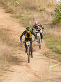 Two xc riders struggling for victory. Two xco riders struggling for victory. One tries to overtake another. Cross-country cycling trail Stock Photography
