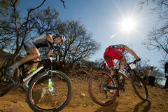 Two XCO riders climbing through corner Stock Photos