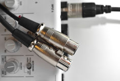 Two XLR connector (male) over sound mixer. Stock Image