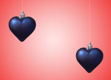 Two xmas hearts on red Stock Images